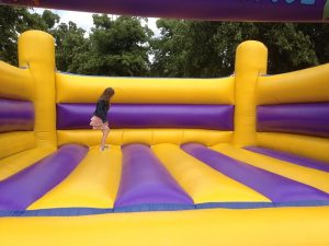 festival style wedding - bouncy castle